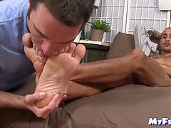 tattooed faggot jerks off while his toes are deepthroated and licked