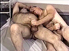 A junior men and elder man toying with each other dick