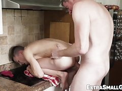 Extra small young man takes it bareback while in the kitchen