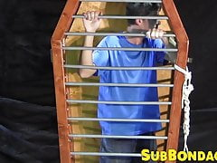 BDSM fun with a dude trapped in a cage by his master