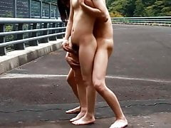 Public young asians spooning and cumming together